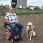 Service Dogs Help Farmers with Disabilities Do Their Jobs
